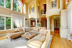 Beautiful family room with a full 2 story wall of windows.